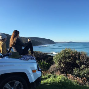 People looking at view from lookout on Great Ocean Road
